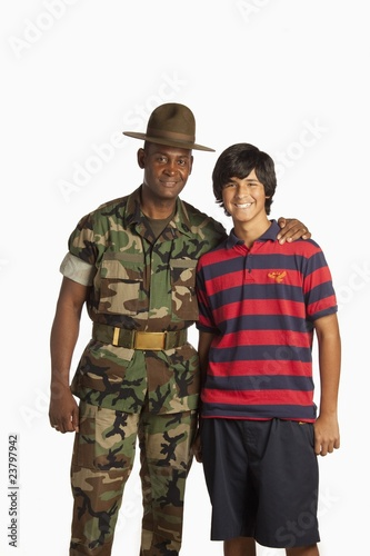 A Military Man With His Arm Around A Teenage Boy