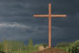 A Cross On A Hill With A Dark Sky