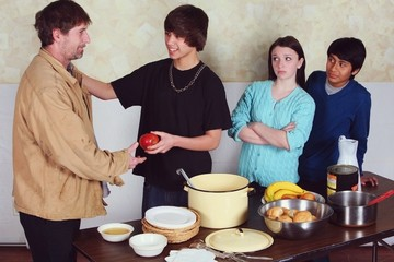Teenagers Serving A Meal To A Man