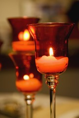 Candles Lit In A Glass Candle Holder
