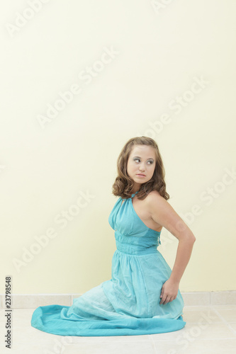Woman sitting in a blue dress