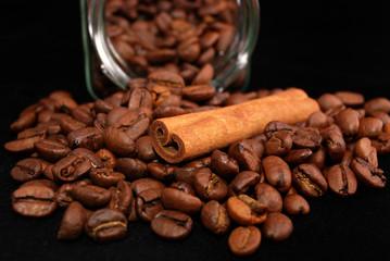 grains of coffee and stick cinnamon