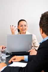 Business woman explaining at meeting