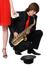 Girl alms to a man who plays the sax