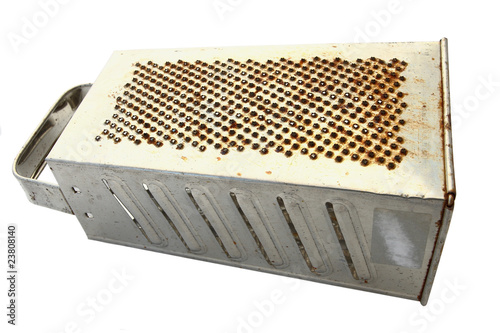 old metal vegetable grater,over white
