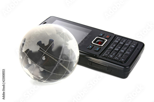 glass globe and mobile telephone