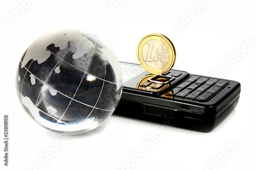 glass globe is a mobile telephone and coin 1 euro