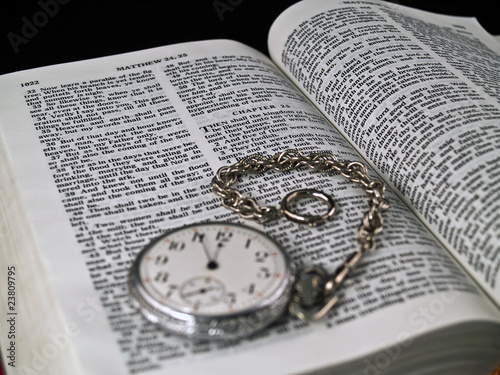 The Bible opened to Matthew 24: 36 with a Pocketwatch