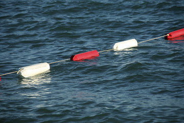 an image of several buoys on the water