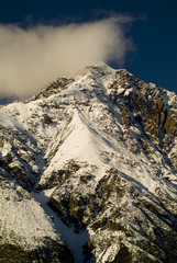 Snow capped peaks with sharp ridges and spin drift