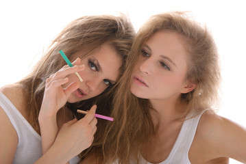 Two young women with cigarettes
