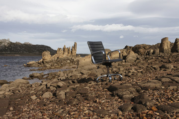 Lonely chair on the rocks