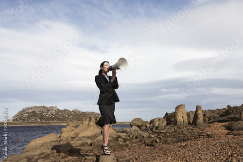 Businesswoman with a loud speaker