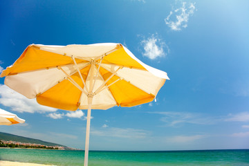 Orange umbrella on beautiful beach