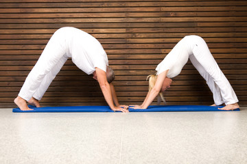 Couple performing yoga exercises