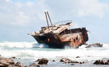 Aghullas shipwreck lying on the rocks in the breakers poster
