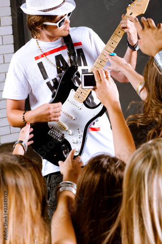 Guitarist performing for his adoring fans