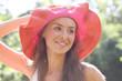 Pretty cheerful woman in the garden