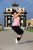 woman modern ballet dancer in sity against classic arch