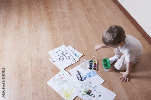 Young boy with paintbox