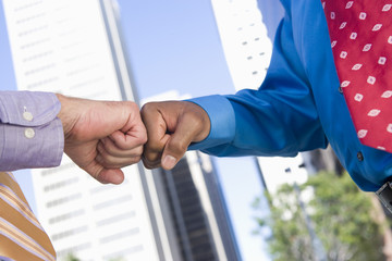 Close-up of businessmen greeting each other  outdoors