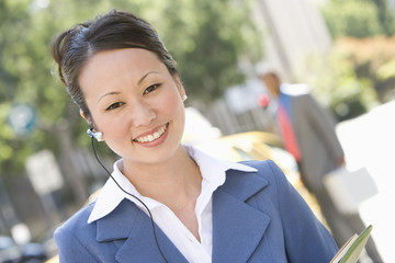 Portrait of young businesswoman at street