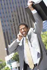 Businessman celebrating at street