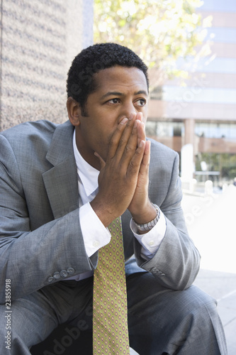 Mid-adult businessman outdoors  thinking