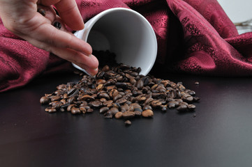 coffee granules on black table with hand