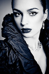 Beautiful fashion girl on the grey background