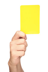 Hand holding a yellow card isolated on white