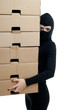 thief in black clothes and balaclava with boxes.