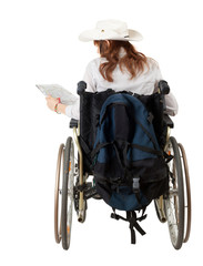 female tourist on the wheelchair with map