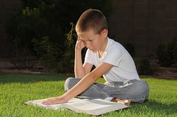 Outdoor boy reading