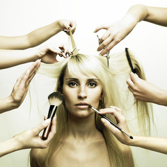 Model and hands of stylists