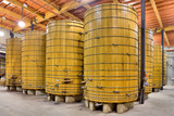 Large Wine Barrels in a California Winery Cellar poster