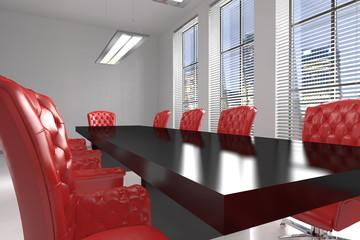 Sala riunioni con sedie rosse
