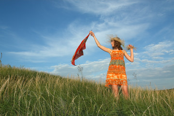 girl in the field with a shawl