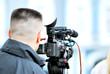 cameraman worcking with camera on a tripod