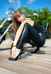 A pretty woman near by motorcycle