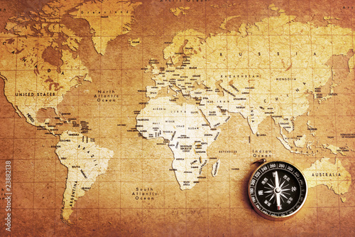 An old brass compass on a Treasure map background - 23882138