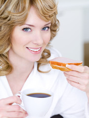 Smiling woman with cup of coffee