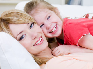 Happy mother with smiling daughter