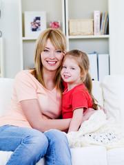 Woman embracing her daughter