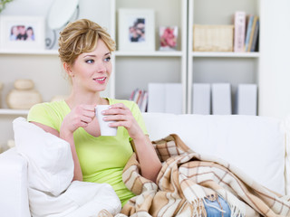 Woman with cup of warming beverage