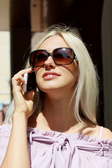 charming young blonde talking on the phone
