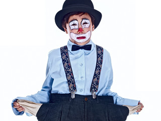 crying child clown showing his empty trousers pockets