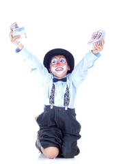 happy child clown raising both hands full of money