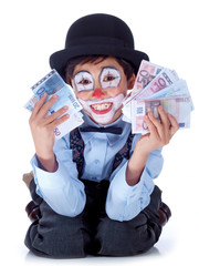 happy child clown showing both hands full of money