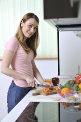 happy young  woman in kitchen